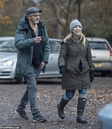 Colin Firth walks in the park with BBC newscaster Joanna