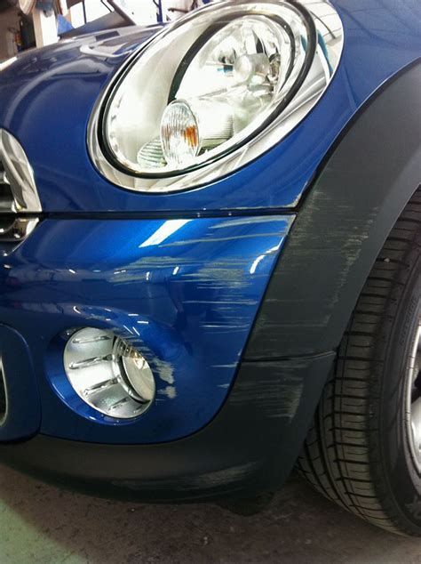 Badly scratched car bumper – Paintmedic