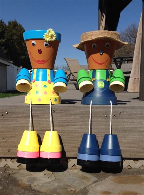 Cheap DIY Clay Pot People To Cheer Up Your Garden
